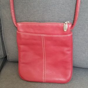 Red leather Authentic Tignanello crossbody bag.